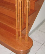 spindles mounted on new hardwood planks